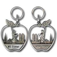 "Let someone know that they're #1 with this ""#1 Sister Apple Zipper Pull."" If they're #1 in the big apple, that puts them pretty high for #1 in the world! The zipper pull measures 1"" x 1 1/2""."